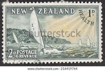 NEW ZEALAND - CIRCA 1951: A Cancelled postage stamp from New Zealand illustrating a yachting race, issued in 1951.