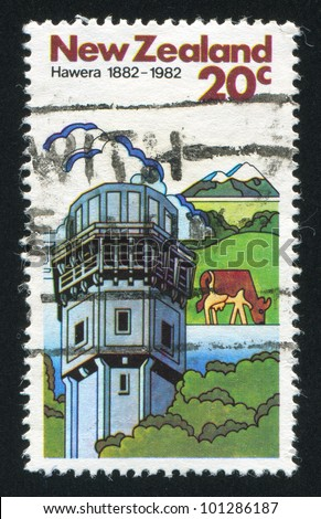NEW ZEALAND - CIRCA 1982: A stamp printed by New Zealand, shows Cows and Dairy Factory in Hawera, circa 1982