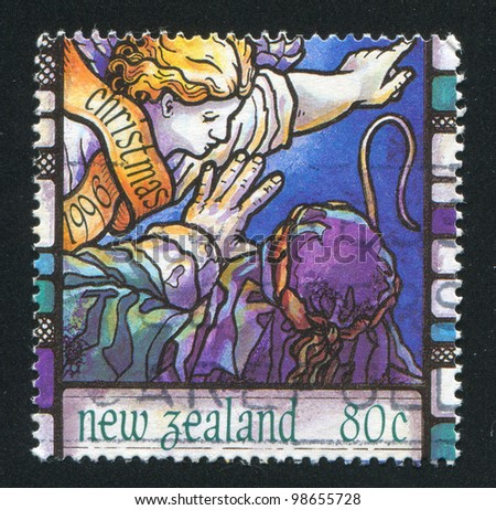 NEW ZEALAND - CIRCA 1996: A stamp printed by New Zealand, shows Scenes from the Christmas story, Angels announcement to shepherd, circa 1996 - stock photo