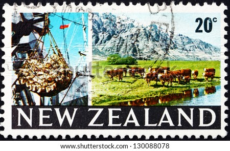 NEW ZEALAND - CIRCA 1969: a stamp printed in the New Zealand shows Cargo Hoist and Grazing Cattle, circa 1969 - stock photo