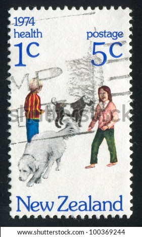 NEW ZEALAND - CIRCA 1974: stamp printed by New Zealand, shows children with dogs, circa 1974