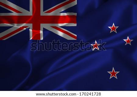 New Zealand flag on satin texture. - stock photo