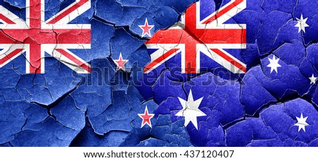 New zealand flag with Australia flag on a grunge cracked wall