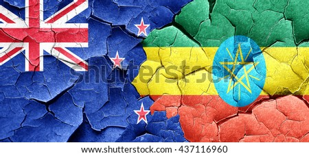 New zealand flag with Ethiopia flag on a grunge cracked wall - stock photo