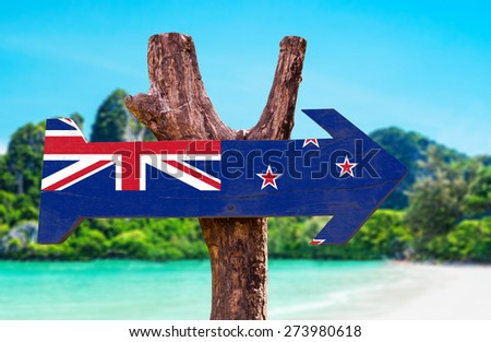 New Zealand Flag wooden sign with beach background - stock photo