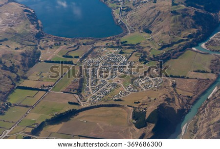 NEW ZEALAND - MAY 14: View from the sky on the suburb of Queenstown in the South Island of New Zealand on May 14, 2011 in Lake Hayes Estate, Otago, New Zealand - stock photo