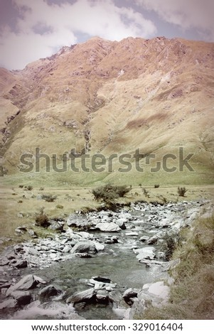 New Zealand - mountains in Mount Aspiring National Park. Cross processed color tone - retro filtered style. - stock photo