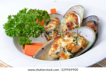 new zealand mussels baked with cheese - stock photo