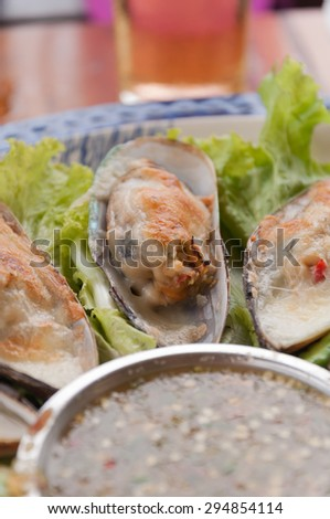 new Zealand mussels baked with cheese. Selective focus. Very shallow Depth of Field, for soft background. - stock photo