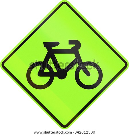 New Zealand road sign - Watch for cyclists, fluorescent green version.