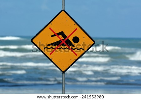 New Zealand sea warning sign at the beach with man swim and not symbol, Caution No Swimming allowed. concept conceptual. - stock photo