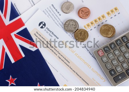 New Zealand Tax concept annual IR10 tax form with New Zealand coins and flag - stock photo