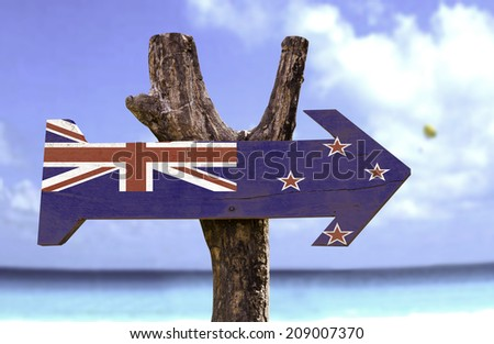 New Zealand wooden sign with a beach on background  - stock photo