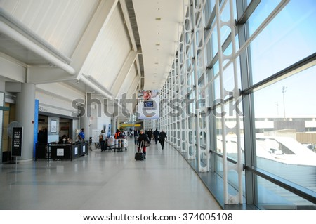 NEWARK, NJ - FEB 7: Newark Airport interior with waking passengers. Feb 7, 2016 in Newark, New Jersey. The airport near New York City is 10th busiest in US
