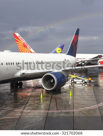 NEWARK, USA - SEPTEMBER 13, 2015: Rainbow over three airplanes at Newark Liberty International Airport (EWR). Airport is a major hub for United Airlines, the airport's largest tenant.
