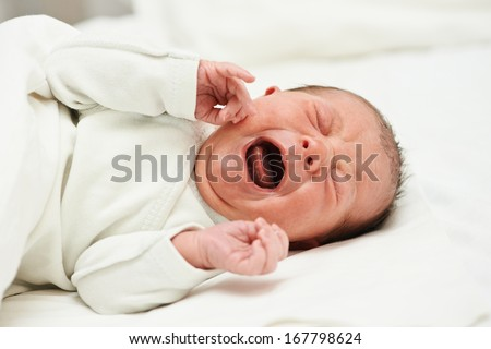 newborm baby screaming just after born - stock photo