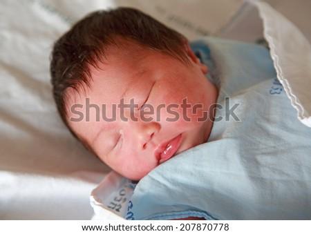newborn baby Aged 2 Days sleep in the blanket - stock photo