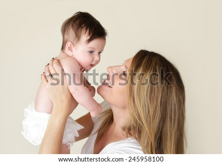 Newborn baby and mother, mom holding baby  - stock photo