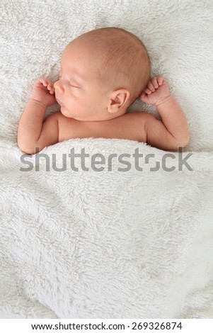 Newborn baby boy asleep on a blanket. Also available in horizontal.  - stock photo
