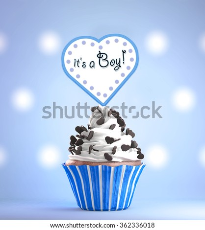 Newborn Baby Boy card message on a delicious cupcake with chocolate hearts - stock photo