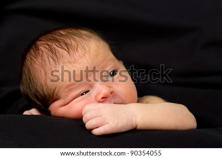 Newborn Baby boy on a black background - stock photo