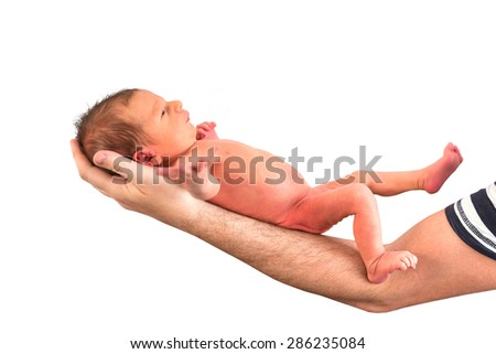 Newborn baby boy on dads hand over white background - stock photo