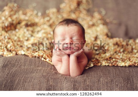 Newborn baby boy on his elbows - stock photo