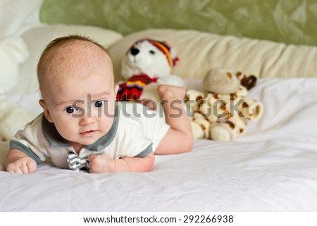 Newborn baby boy portrait with teddy bears and toys