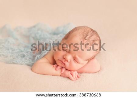 Newborn baby boy sleeping  - stock photo