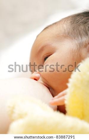 Newborn baby breast feeding breast - stock photo