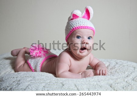newborn baby dressed as a bunny and yawns - stock photo