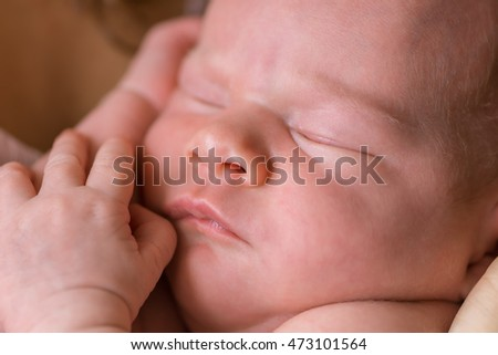 Newborn - baby, face close-up (shallow depth of field)