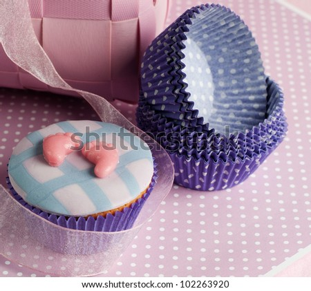 newborn baby feet cupcake with empty cups - stock photo
