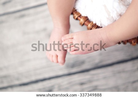 Newborn baby feet in shallow depth of field