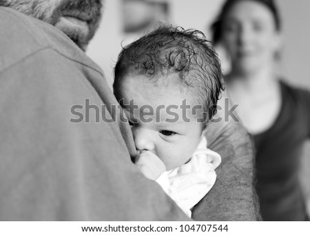 Newborn baby girl and father. Child abuse concept.