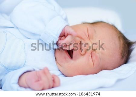Newborn baby girl crying , ten days old. - stock photo
