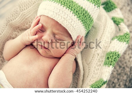 Newborn baby girl, 7 days old, sleeping on soft blanket - stock photo