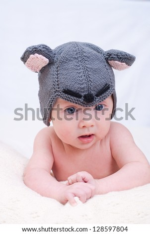 Newborn baby girl in a mouse cap - stock photo