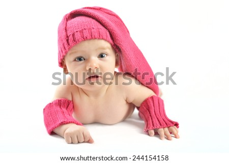 newborn baby girl in pink knitted hat and mittens on a white background - stock photo