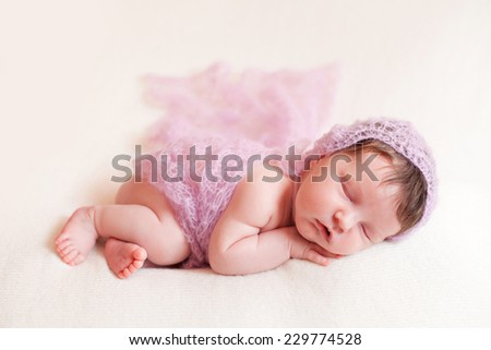 Newborn baby girl in pink shawl set - stock photo