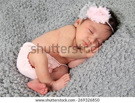 Newborn baby girl of Asian and Caucasian heritage.  - stock photo