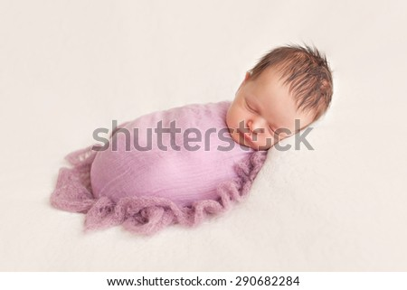 Newborn baby girl posing on white background
