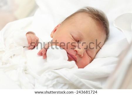 Newborn baby girl sleeping. - stock photo
