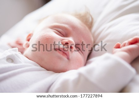 Newborn Baby Girl Sleeping In Bed - stock photo