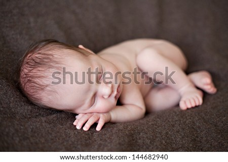Newborn baby girl sleeping. Shallow DOF