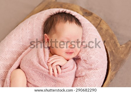 Newborn baby girl with smile - stock photo