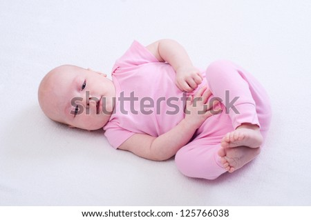 Newborn baby girl with toys - stock photo