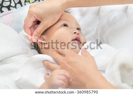 Newborn baby having a bath ,have fun in the bath time - stock photo
