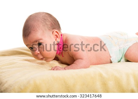 Newborn baby having torticollis neck waiting for massage - stock photo
