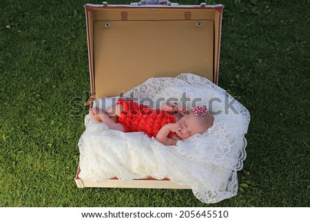 Newborn Baby in a Red Dress - stock photo
